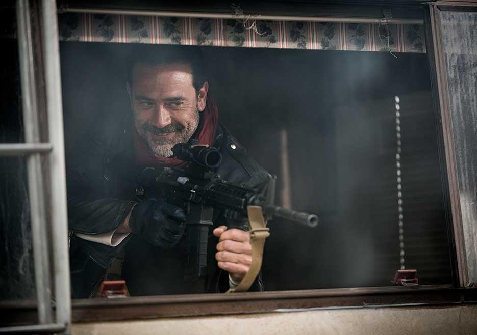 Negan holds up a gun