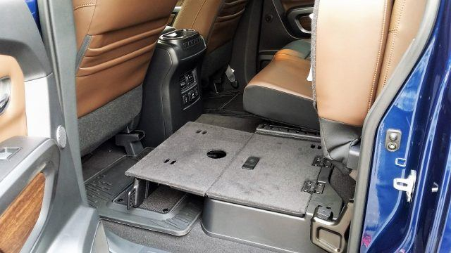 The Nissan Titan's folding rear seat is packed full of different configurations and useful storage and transit touches | Micah Wright/Autos Cheat Sheet