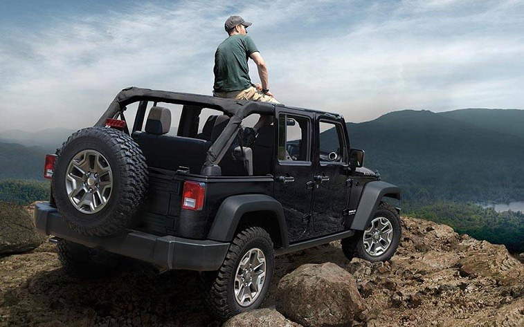 View of 2016 Wrangler parked at edge of a rocky precipice.