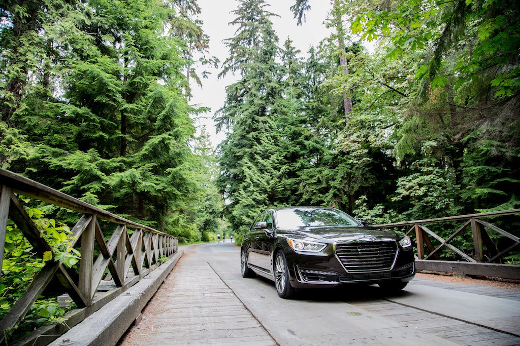Black 2017 Genesis G90 on a wooden bridge.