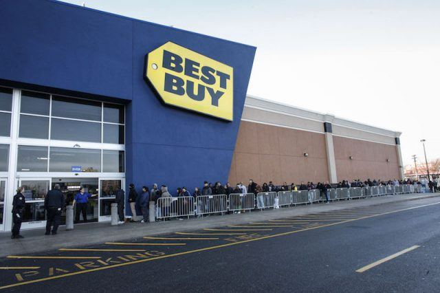 A Best Buy Employee opens the door to Customers for Black Friday Sales on November 27, 2015 in Jersey City, New Jersey. It was expected that 135.8 million Americans would shop this Black Friday weekend, according to the National Retail Federation .