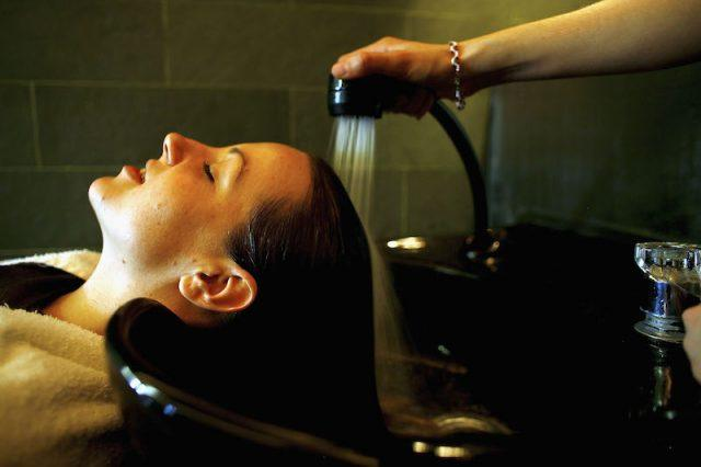 Woman getting her hair washed