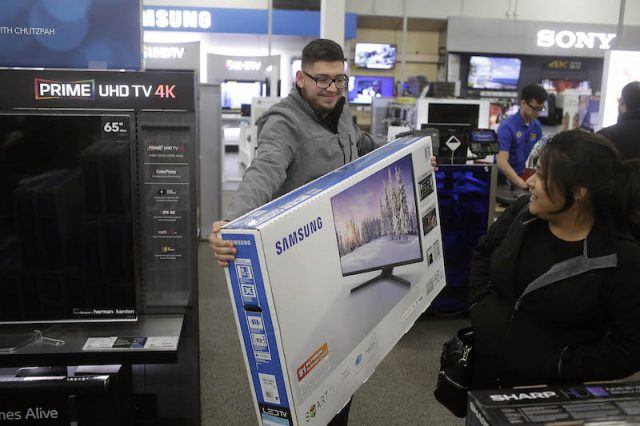 A customer holds a 48-inch television at a Best Buy on November 27, 2015 in Skokie, Illinois. Many retail business across the country offer deep discounts to consumers on Black Friday, the day after Thanksgiving, which starts the holiday shopping season.