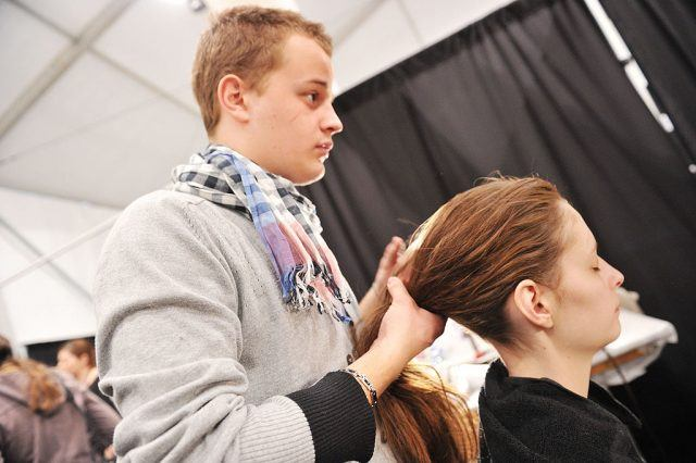 NEW YORK, NY - FEBRUARY 16: A model prepares backstage at the Yigal Azrouel Fall 2011 fashion show during Mercedes-Benz Fashion Week at The Studio at Lincoln Center on February 16, 2011 in New York City.