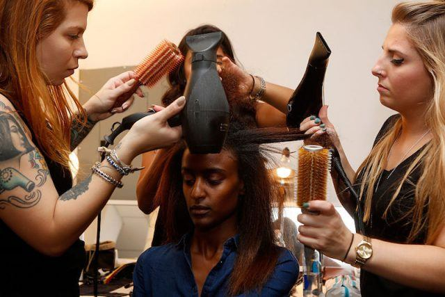 NEW YORK, NY - SEPTEMBER 16: A model prepares backstage with L'Oreal Professionnel hair products at Bibhu Mohapatra Spring 2016 during New York Fashion Week: The Shows at The Gallery at Skylight Clarkson Sq on September 16, 2015 in New York City.