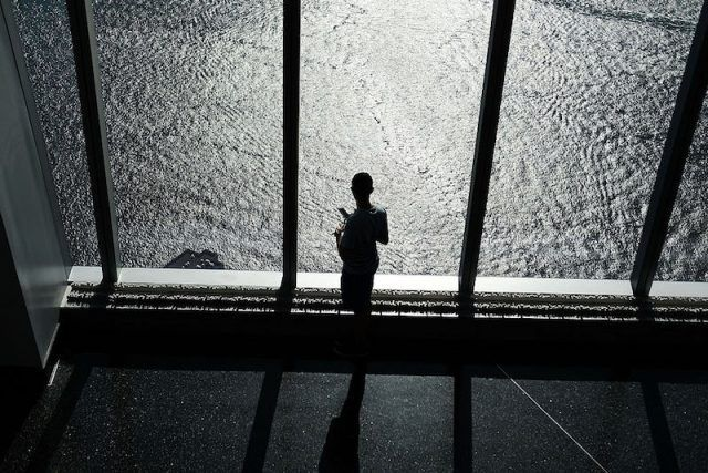 NEW YORK, NY - AUGUST 22: A person looks out at the Hudson River at the One World Observatory at One World Trade Center on August 22, 2016 in New York City.The observation deck sits atop the 104-story skyscraper at the former site of the former Twin Towers and is one of Manhattan's top tourist attractions. People are preparing to commemorate the 15th anniversary of the attacks on September 11, 2001.