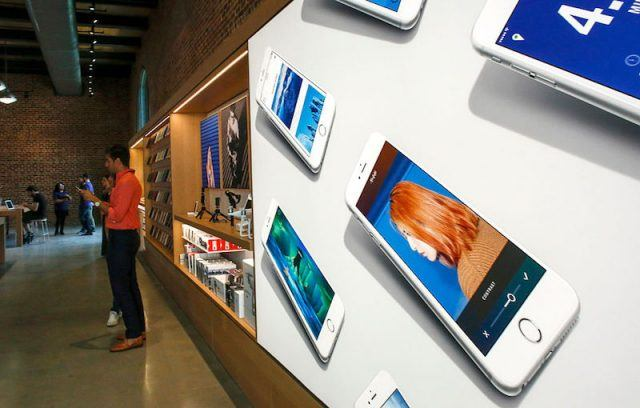 NEW YORK, NY - JULY 28: A poster that contains pictures of iPhones is displayed the new Brooklyn Apple Store during a media preview in the Williamsburg neighborhood of Brooklyn on July 28, 2016 in New York City. The Williamsburg Apple Store opens next Saturday on July 30th, it is a multi-use space with numerous wood cube seats and a giant 6K video screen.
