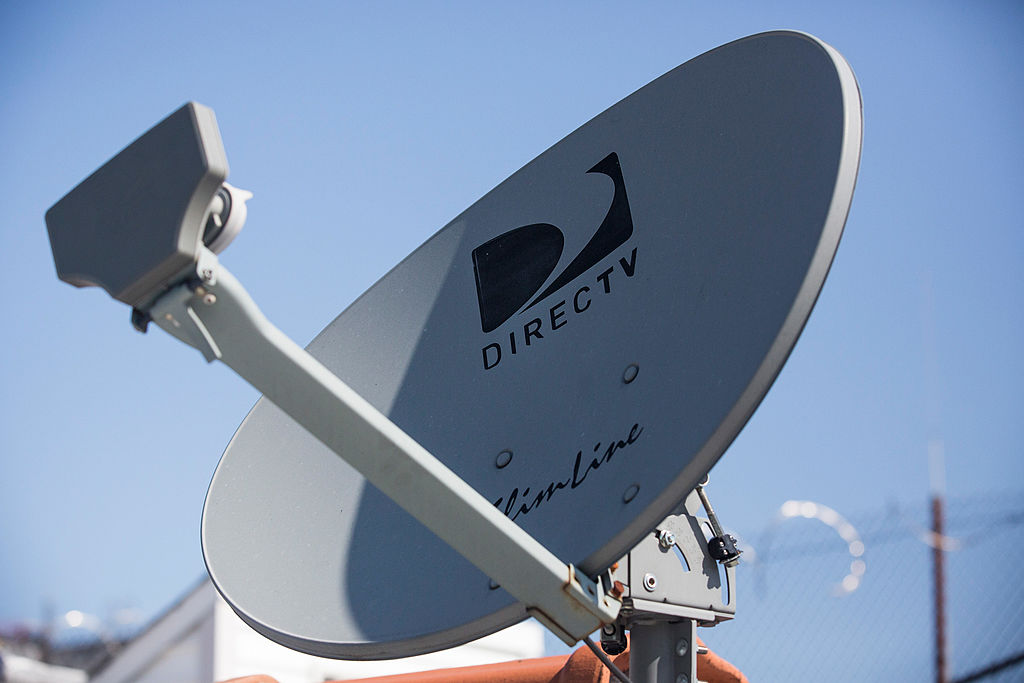 A DirecTV sattelite dish sits on a roof