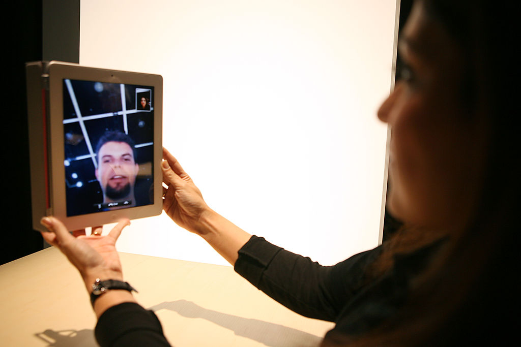 An Apple representative demonstrates the video chat feature