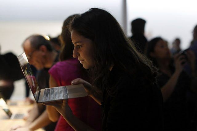 An attendee looks into the new Apple MacBook during a product demonstration after an Apple special event at the Yerba Buena Center for the Arts on March 9, 2015 in San Francisco, California. Apple Inc. announced the new MacBook as well as more details on the much anticipated Apple Watch, the tech giant's entry into the rapidly growing wearable technology segment as well