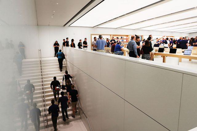 Customers shop at the new Apple Store
