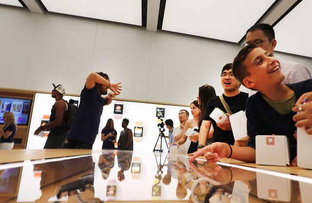 Customers shop at the new Apple Store at the 350,000 square-foot World Trade Center