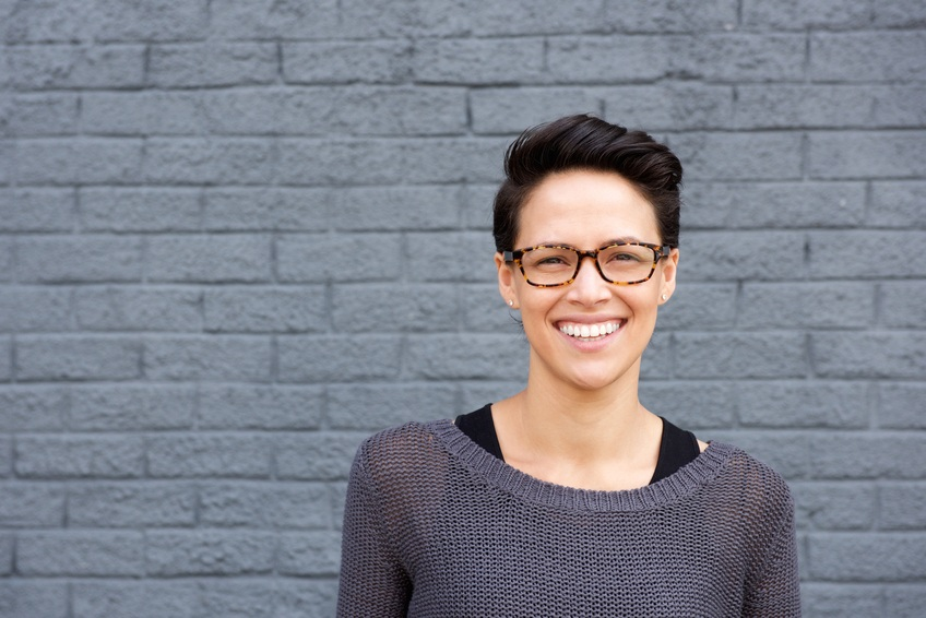 smiling woman wearing glasses