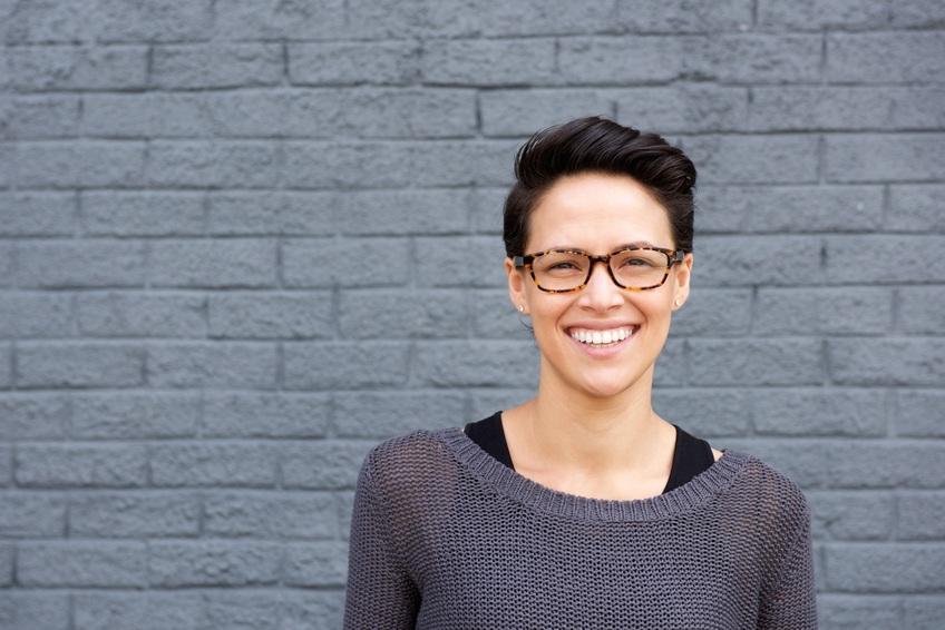 smiling woman wearing glasses