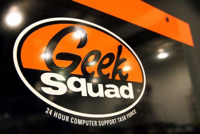 """NILES, IL - JUNE 06: A """"Geek Squad"""" sign hangs on a door to its computer repair facility in a Best Buy store June 6, 2006 in Niles, Illinois. Best Buy is reportedly testing their """"Geek Squad"""" computer service and technical repair in ten Office Depot stores in Orlando, Florida."""