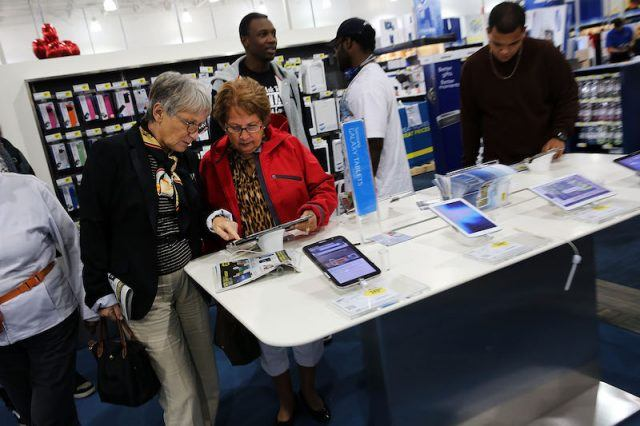 Black Friday shoppers looks for deals at a Best Buy store