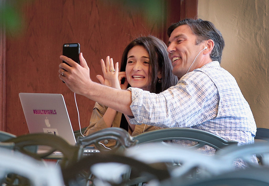 Sheryl Sandberg, chief operating officer of Facebook Inc., and Tim Armstrong, chief executive officer of AOL Inc