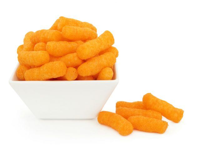 Cheese puff snacks in a porcelain dish