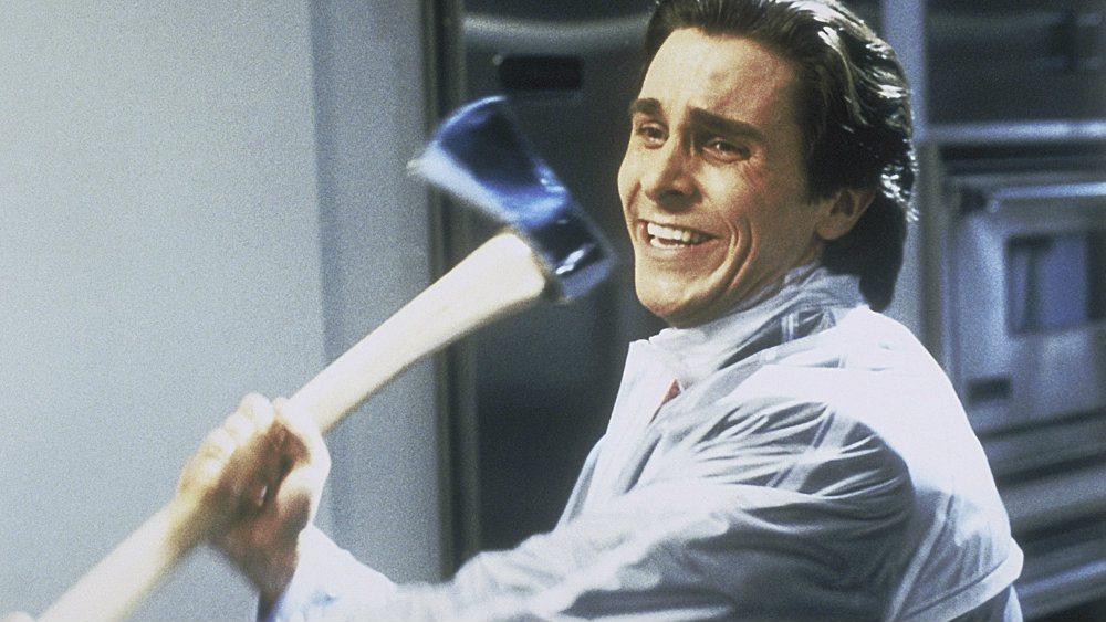 Christian Bale as Patrick Bateman in American Psycho is swinging an axe.