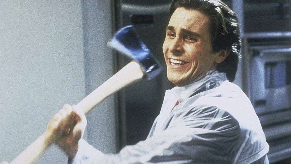 Christian Bale as Patrick Bateman in American Psycho is swinging an axe.