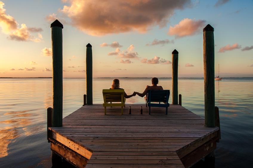 Couple sits on dock