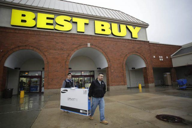 Customers holds a 55-inch television as they exit a Best Buy on November 27, 2015 in Skokie, Illinois. Many retail business across the country offer deep discounts to consumers on Black Friday, the day after Thanksgiving, which starts the holiday shopping season.