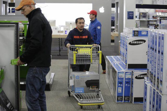 SKOKIE, IL - NOVEMBER 27: Customers shop for electronics and other items at a Best Buy on November 27, 2015 in Skokie, Illinois. Many retail business across the country offer deep discounts to consumers on Black Friday, the day after Thanksgiving, which starts the holiday shopping season.