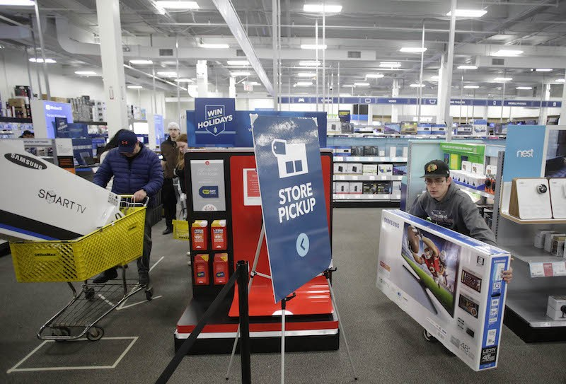 Customers shop for electronics at Best Buy