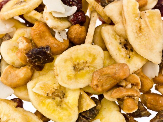 Dried fruits and nuts in a white background.