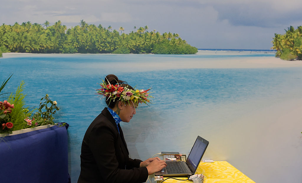 A fair hostess uses laptop at booth