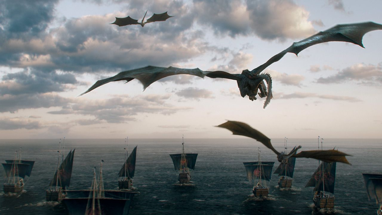 Dragons flying above a fleet of ships sailing away