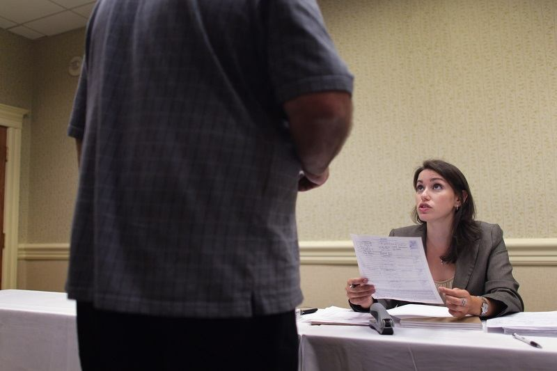 Amanda Winchip, District Manager for grocery retailer ALDI , takes an application from a person looking to fill a job opening in one of the new stores opening in the South Florida area on September 7, 2010 in Fort Lauderdale, Florida. The unemployment rate in Florida has stayed around 11.5 percent.