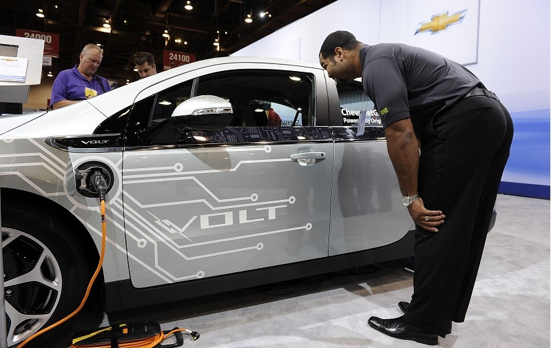 An attendee looks at a 2011 Chevrolet Volt electric car modified with concept Z-Spec accessories at the Specialty Equipment Market Association (SEMA) trade show in Las Vegas, Nevada November 4, 2010. General Motors (GM) first unveiled the Chevy Volt concept in January 2007 and the car is expected to be at dealerships in early 2011. The SEMA show is the premier automotive specialty products trade event in the world drawing more than 100,000 industry leaders from more than 100 countries. AFP PHOTO / Robyn Beck (Photo credit should read ROBYN BECK/AFP/Getty Images)