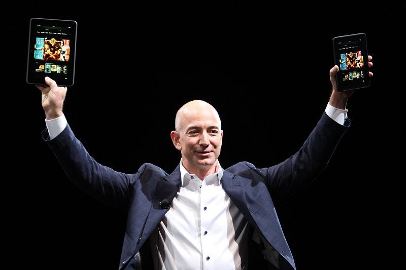 Jeff Bezos holds up the Kindle Fire HD