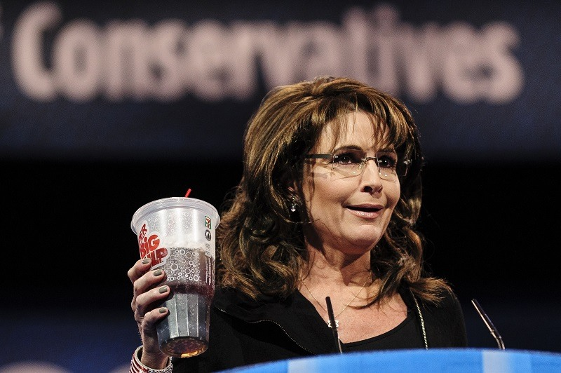 Sarah Palin, former Governor of Alaska, holds up a large soda as she speaks about New York City Mayor Michael Bloomberg's proposed large soda ban and tax in 2013