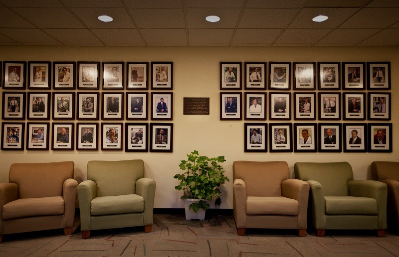 Images on the wall of fame inside Monsanto agribusiness headquarters in St Louis