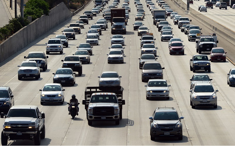 Motorists make their way out of downtown Los Angeles headed east on the Interstate 10 freeway on August 30, 2013 in California, where more Southern California residents are taking Labor Day weekend trips this year compared to in 2012, according to the Automobile Club of Southern California. Some 2.44 million residents have plans for a trip of at least 50 miles from home this Labour Day weekend, with about 1.93 million expected to drive, up 6.2 percent from 1.82 million last year, according to the Auto Club.