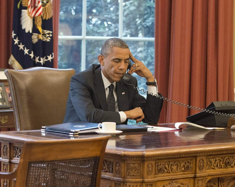 Obama speaks with King Abdullah II of the Hashemite Kingdom of Jordan on the phone from the Oval Office in August 2014