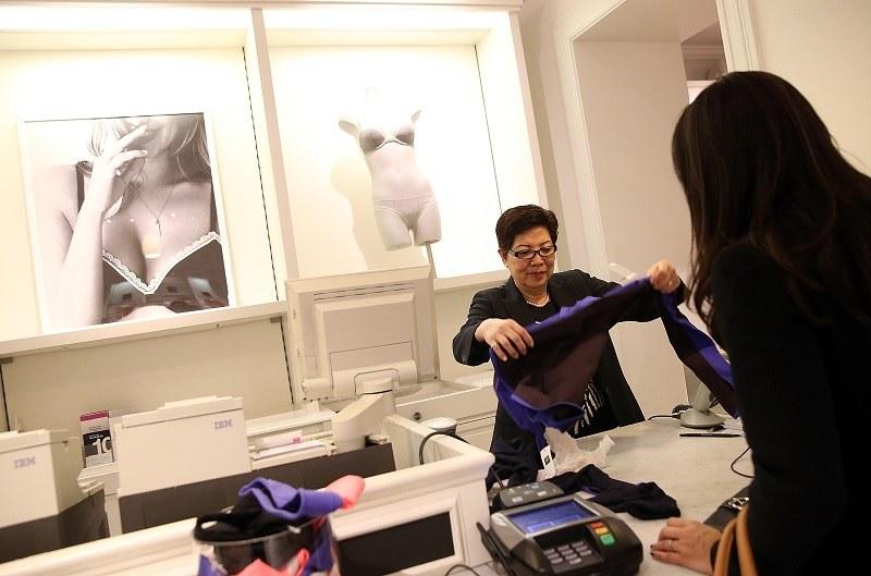 A minimum wage retail employee hard at work
