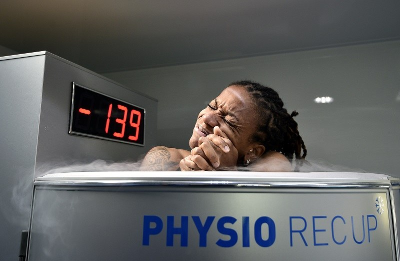 A woman in a cryotherapy tank