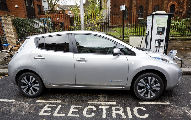 Go Ultra Low Nissan LEAF on charge on a London street. Ultra-low emission vehicles such as this can cost as little as two pence (British) per mile to run.