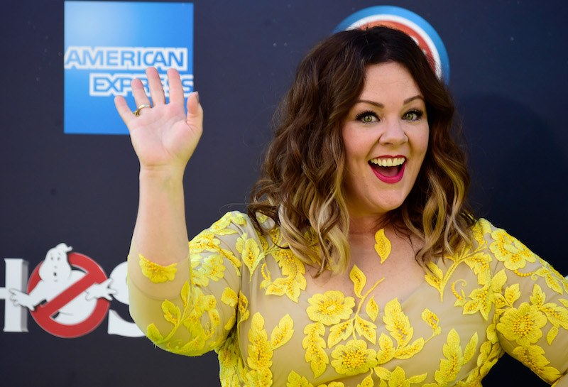 Melissa McCarthy waves and smiles