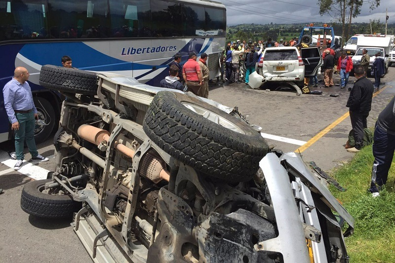 """Riot police officers and other people assist the governor of Boyaca, Carlos Amaya (in vehicle), after a road accident between the cities of Tunja and Duitama, Boyaca Department, Colombia, on July 12, 2016. According to a statement released by Boyaca' Government press office citing witnesses, his caravan collided with """"obstacles put in the way by striking truck drivers. / AFP / Edwin Camargo (Photo credit should read EDWIN CAMARGO/AFP/Getty Images)"""