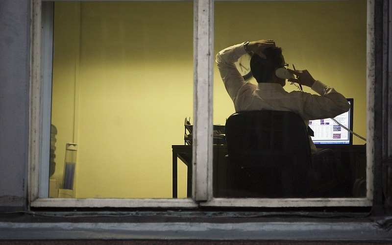 An office employee feels the effects of sitting all day, and getting little exercise