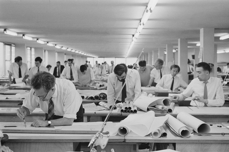 Designers, engineers and draughtsmen working on designs