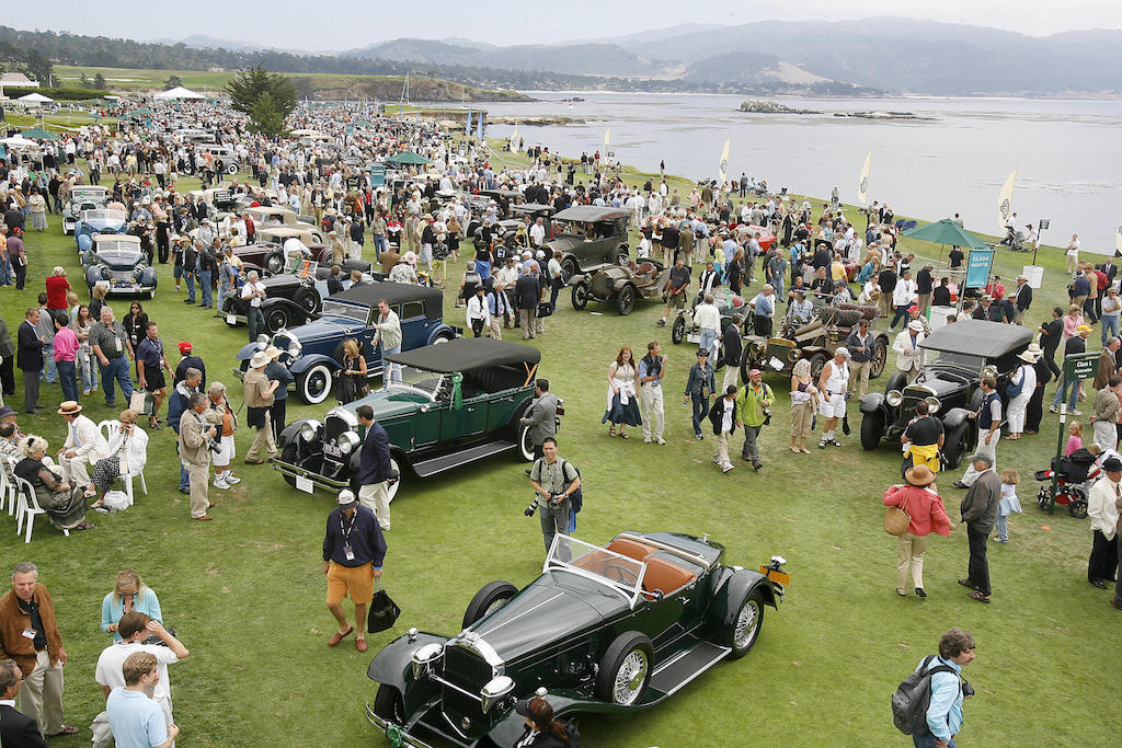 Cars line the 18th fairway at the Pebble Beach Concours