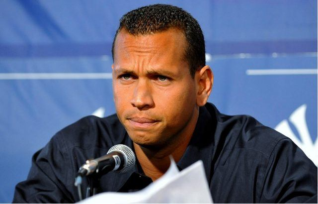 Alex Rodriguez sits in front of a microphone during a press conference.