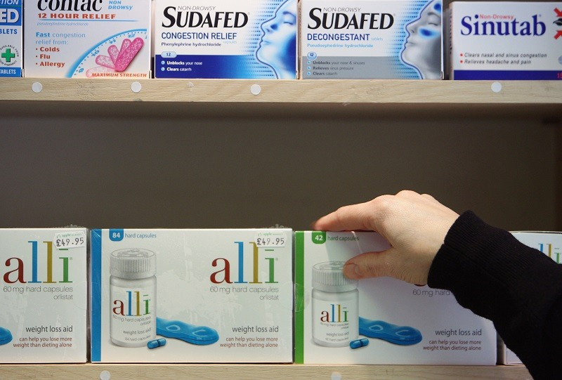 Alli slimming pill is displayed for sale