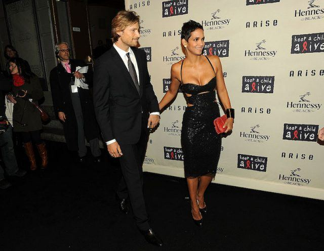 Halle Berry and Gabriel Aubry hold hands while walking at the 'Keep a Child Alive' event.