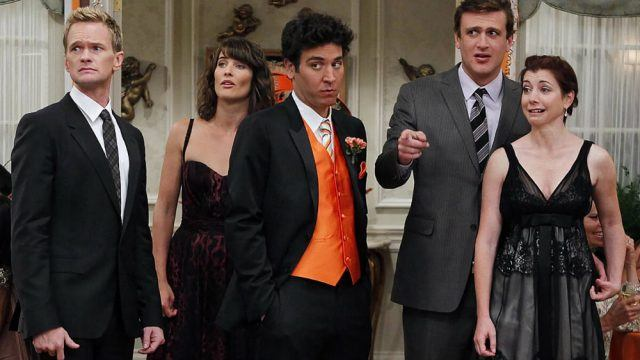 'How I Met Your Mother' friends standing next to each other all dressed up.